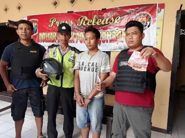 Risky Indra Wardana, 25, warga Dusun Rowoasri, Desa/Kecamatan Rowokangkung, Kabupaten Lumajang saat diamankan di Mapolsek Diwek.