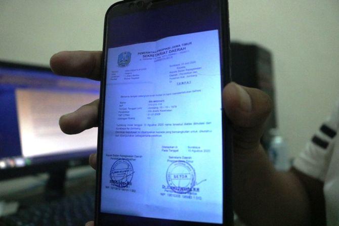 Foto surat mutasi aparatur sipil negara (ASN) palsu dari Surabaya ke Pemkab Jombang yang ternyata palsu.