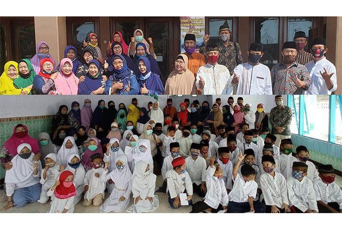 KOMPAK: Panitia santunan Muharram Masjid Jomper bersama anak yatim penerima santunan.