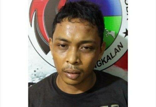 BERKERINGAT: Faisal Rahman saat difoto polisi.