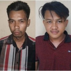 Fajar dan Salamin (kiri) difoto polisi sebelum disel pada Senin lalu (12/8 ).
