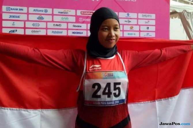 Karisma Evi Tiarani usai memastikan mendapatkan medali emas di Asian Para Games 2018 di Jakarta,
