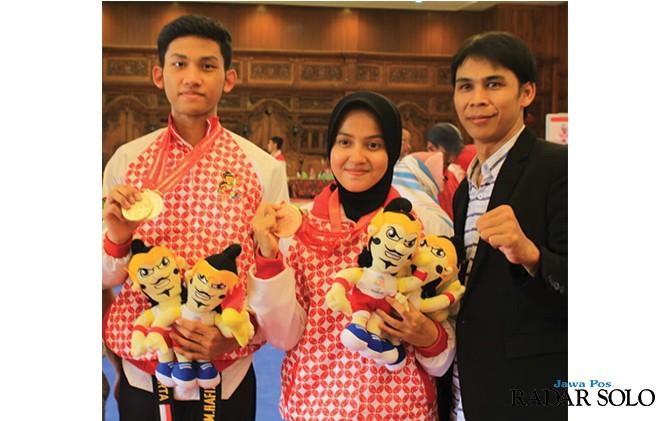 LEGA: Pasangan Muhammad Hafizh Fahrur Rhozy dan Hanafia Salma Arifani sukses meraih emas di Porprov 2018.