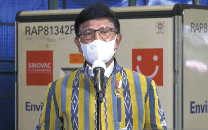 Menteri Komunikasi dan Informatika Johnny G. Plate saat konferensi pers daring terkait kedatangan vaksin Covid-19 di Bandara Soekarno-Hatta.