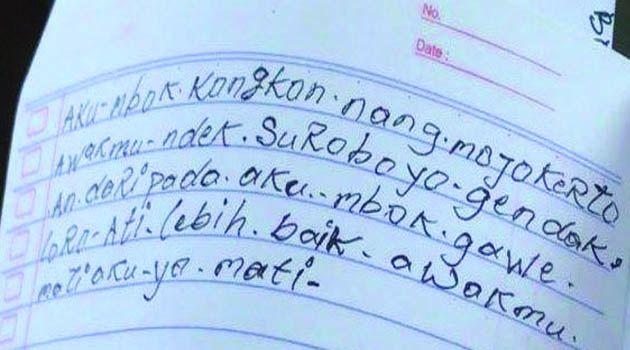 TANDA: Tulisan tangan diduga dari Sumardi tentang tewasnya dia dan istrinya.