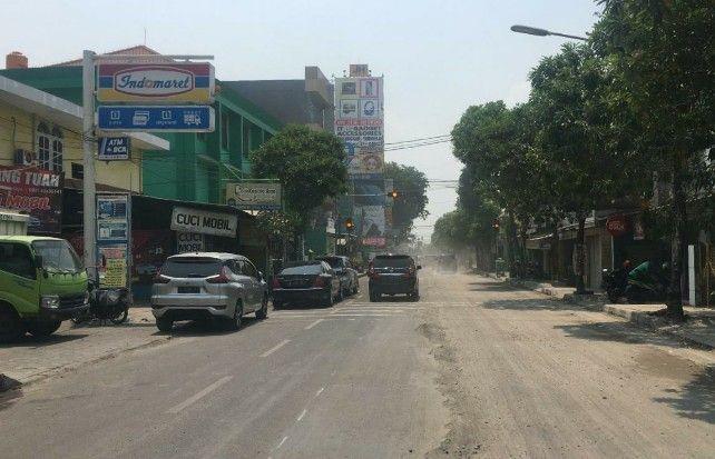 BERDEBU: kondisi Jalan KH Mukmin mengalami pemeliharaan berkala oleh Dinas PU Bina Marga.