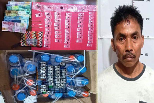 PENGEDAR:  Tersangka penyedia sabu, Sayyedi, 52, warga Madura diamankan beserta 50 poket SS lengkap dengan peralatan isapnya.