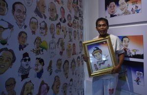 Gun-Gun Pamerkan 200 Kartun Jokowi di Galeri Buku Wartam