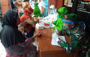 TNI Bantu Rapid test Warga Pasar