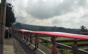 Bentangkan Bendera Merah Putih 1.945 M di Areal Persawahan Jatiluwih
