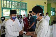 10 Muharam, SMPN 1 Mojoagung Gelar Doa Bersama dan Santunan Anak Yatim