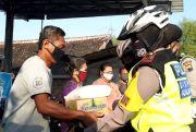 Peringati Hari Korlantas, Satlantas Polres Grobogan Bagi Paket Sembako