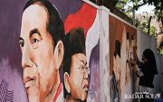 Sambut Pelantikan, Warga Manahan Bikin Mural Jokowi-Ma'ruf